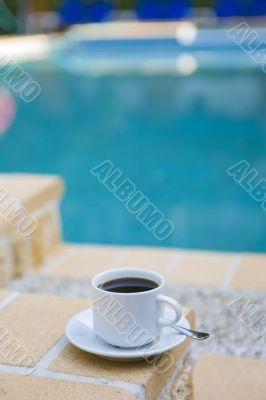 cup coffee on background of the pool