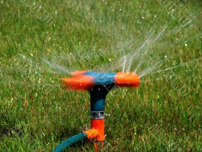 Moving streams sprayer watering lawn