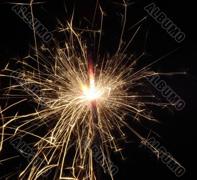 Bright light of sparkling holiday pyrotechnic