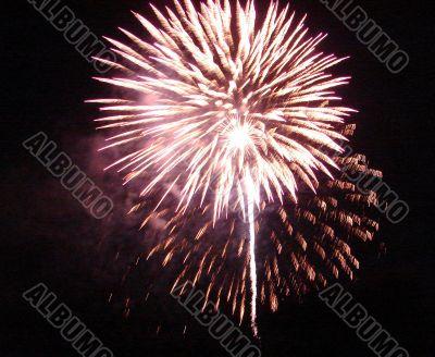 Night celebration fireworks upon dark sky