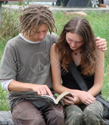 Young stydents reading in street