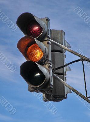 urban stoplight with yellow light