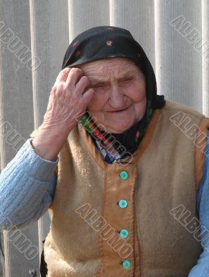 Old Ukrainian country sad granny portrait
