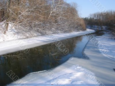 Winter snowy morning riverside