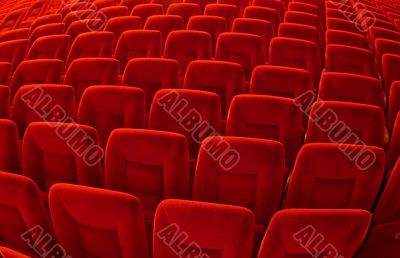 Group of many red seats in public hall