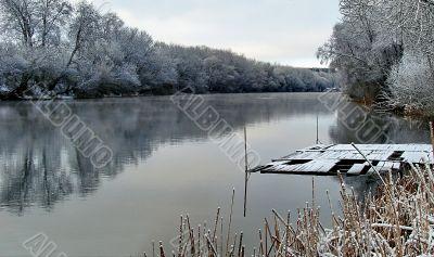 Spring snowy morning riverside