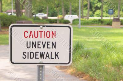 Caution Uneven Sidewalk