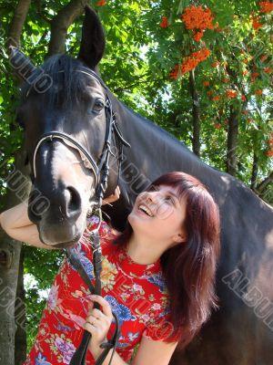 Brunette female model with horse
