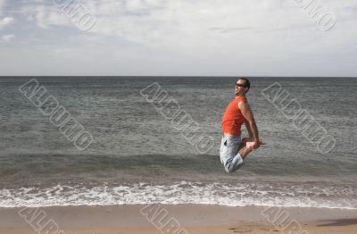 Young active man making a big jump