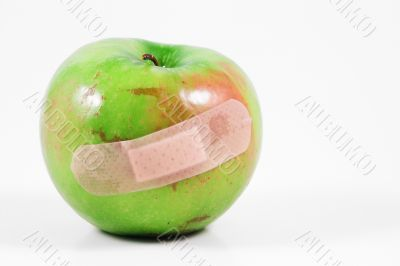 apple with bandaid