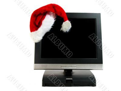 Santa`s hat on a desktop computer