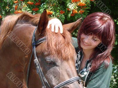 brunette female model closeup with brovn horse