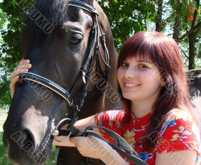 Brunette female model with black horse