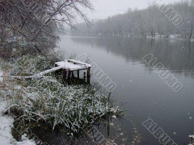 First season snowfall on river