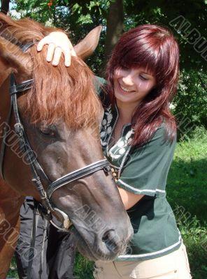 Brunette female model with black horse