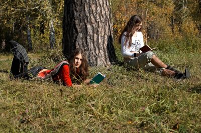 Girls reading  in the park