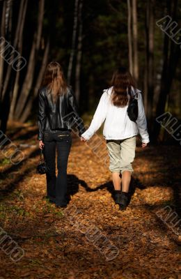 Girls walking in the forest