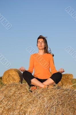 Beautiful woman making yoga