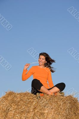 Beautiful woman seated in a field