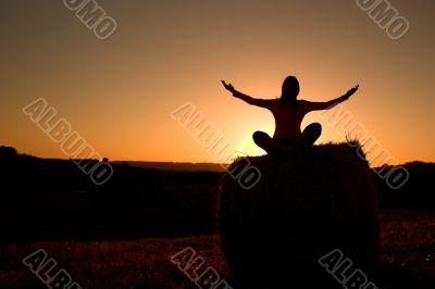 Woman silhouette making yoga