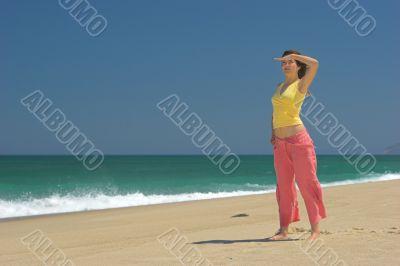 Beautiful woman in the beach watching
