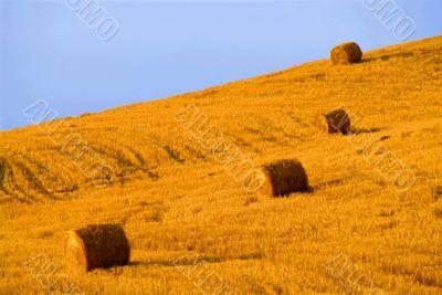 four hay balls