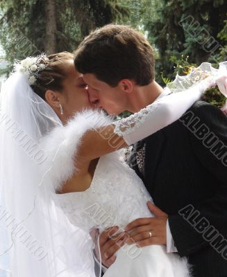 Wedding Kiss of Young Just Married Couple