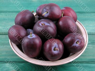 bowl full of fresh plums