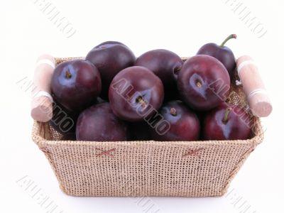 basket full of fresh plums