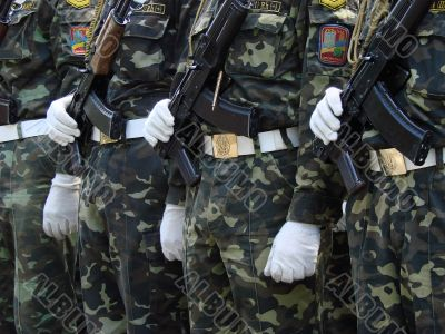 Row of uniformed weaponed soldiers
