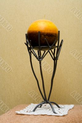 Decorative candlestick with a spherical candle