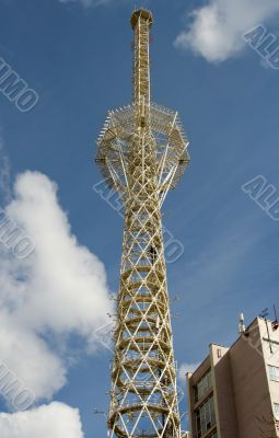Television tower on a background of clouds