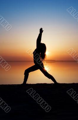 The girl is practising yoga.