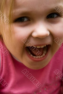 The small shouting girl close up