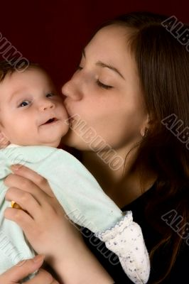 Young mum kissing the favourite son