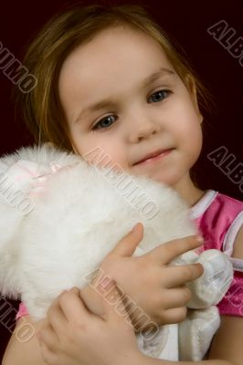 The little girl embracing a favourite toy