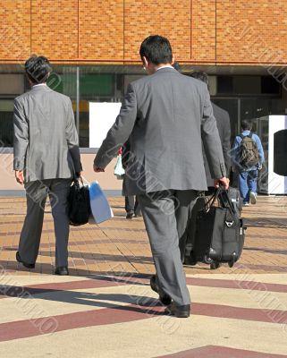 Businessmen travelling