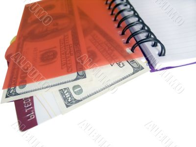 Notebook with dollars and credit card