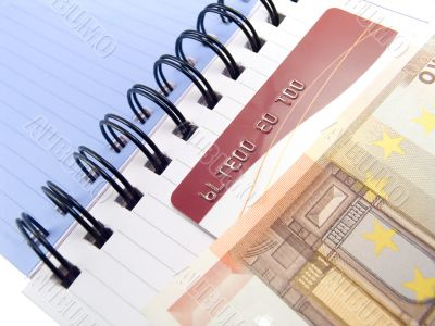 Notebook with Euro and a credit card