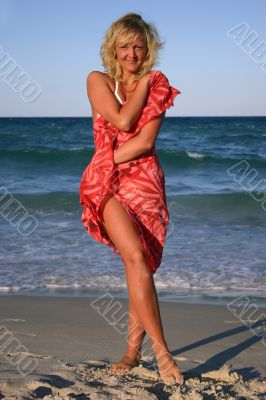 Blonde In The Red Scarf on the beach
