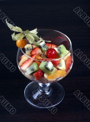 fruit salad in tall wine glass
