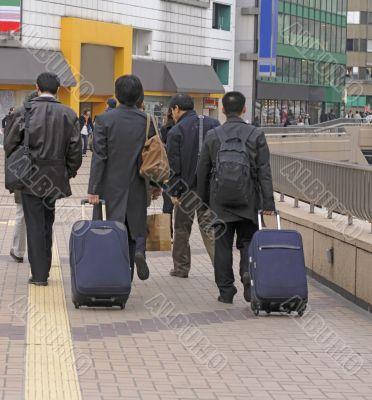 Businessmen travellers group