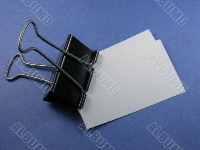 bulldog clip and business cards