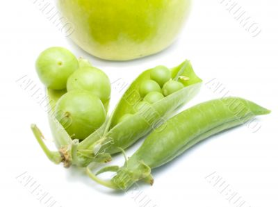 Pods of a green peas, plum and apple