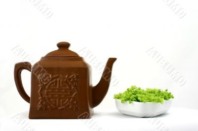 Chinese teapot and fresh green