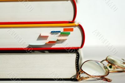 Three books and glasses
