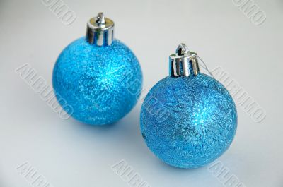 Two blue christmas bulbs