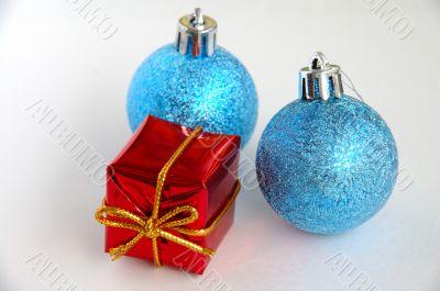 Two christmas bulbs and gift