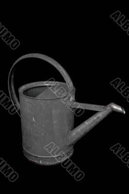 watering can on black