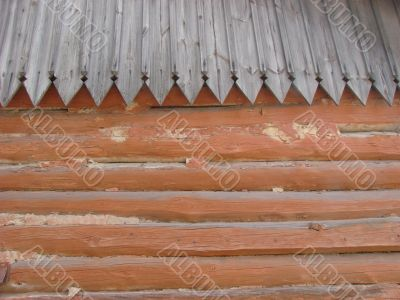 Old log wall and wooden roof